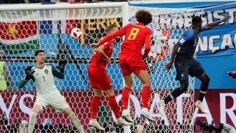 Soccer Football - World Cup - Semi Final - France v Belgium - Saint Petersburg Stadium, Saint Petersburg, Russia - July 10, 2018  France's Samuel Umtiti scores their first goal   REUTERS/Toru Hanai