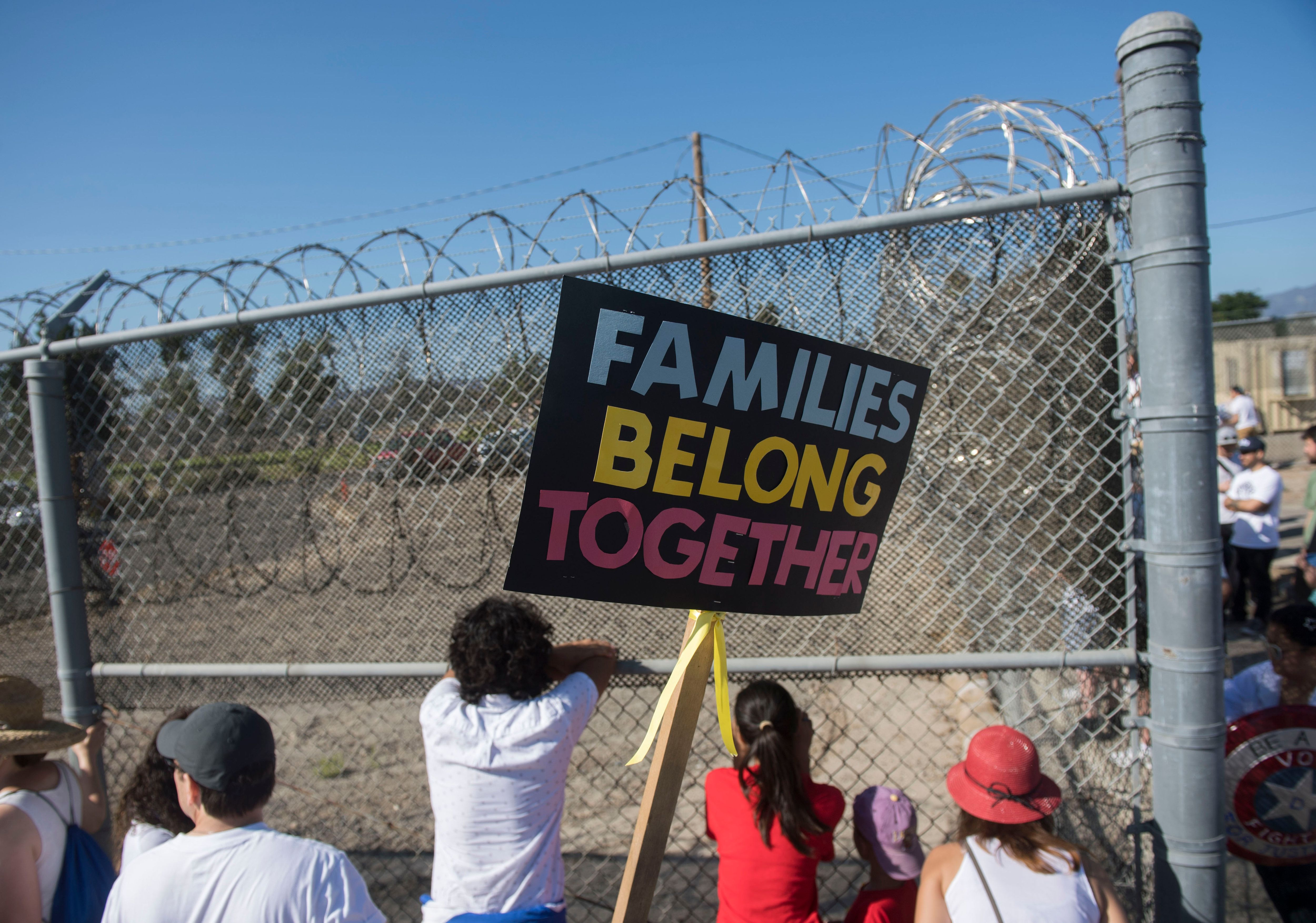 ANAHEIM, CA - JUNE 30: Protesters stand outside the James A. Musick Facility, a detention center that houses unauthorized immigrants, to protest President Trump's immigration policies and demand children be reunited with their families in Irvine on Saturday, June 30, 2018. (Photo by Kevin Sullivan/Orange County Register via Getty Images)