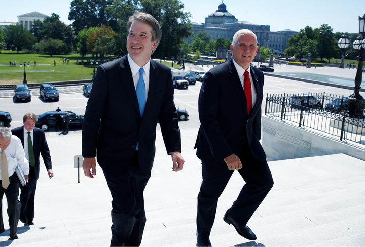 Supreme Court nominee Brett Kavanaugh on Tuesday arrives with U.S. Vice President Mike Pence prior to meeting with Senat