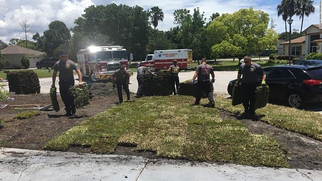 First responders from Pasco County Fire Rescue Station 10 help lay sod after local man Gene Work had a heart attack.