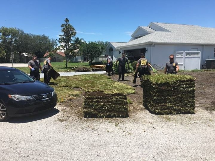 The firefighters who helped Mark Rouco lay down the sod after his brother-in-law's heart attack.