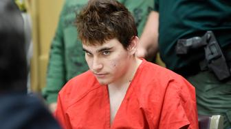 Florida school shooting suspect Nikolas Cruz quickly glances up at the prosecutors while in court before Circuit Judge Elizabeth Scherer for a hearing to move forward the death penalty case on April 27, 2018, in Fort Lauderdale, Fla. (Taimy ALvarez/Sun Sentinel/TNS via Getty Images)