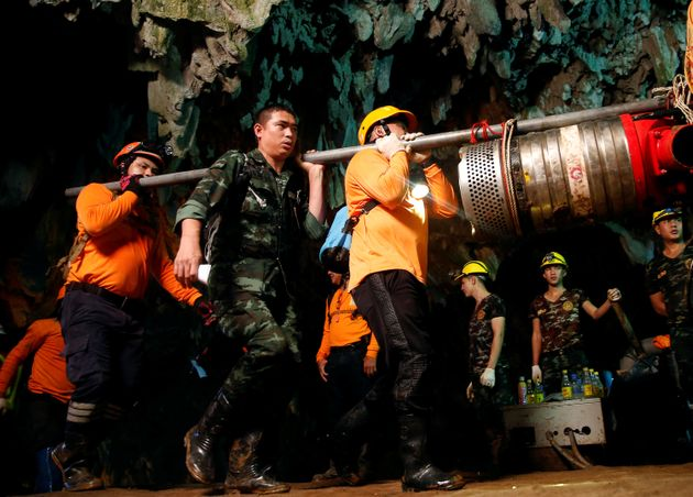 Rescue workers and soldiers take out machines used during the rescue of the Wild Boars football team...