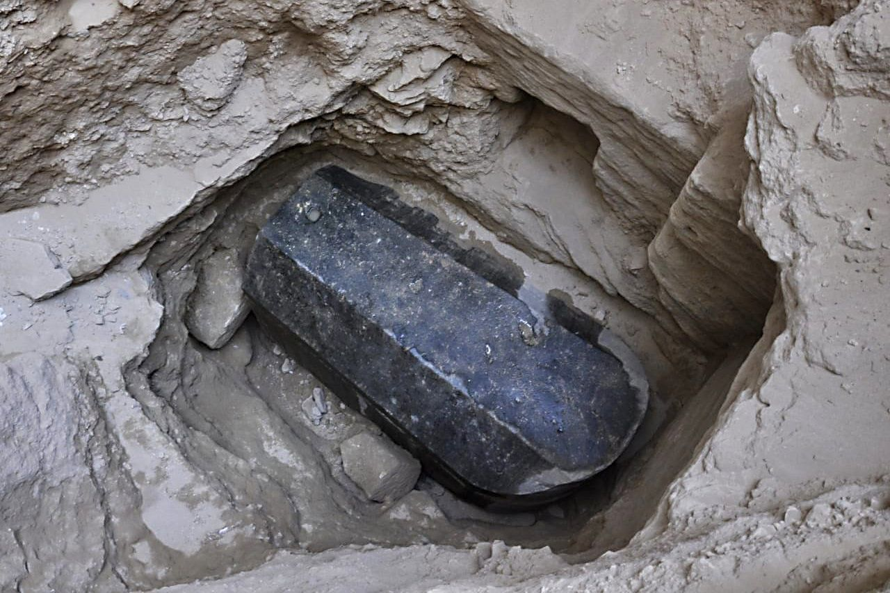 This picture released on July 1, 2018, by the Egyptian Ministry of Antiquities shows an ancient tomb dating back to the Ptolemaic period found in the Sidi Gaber district of Alexandria. - The tomb, which dimensions are a height of 185 cm, length 265 cm and width of 165 cm, contains a black granite sarcophagus considered to be the largest to be discovered in Alexandria. The tomb was found at a depth of 5 meters beneath the surface of the land, there is a layer of mortar between the lid and the body of the sarcophagus indicating that it had not been opened since it was closed in antiquity. An alabaster head of a man was also found and most probably belongs to the owner of the tomb. (Photo by - / various sources / AFP) / XGTY / === RESTRICTED TO EDITORIAL USE - MANDATORY CREDIT 'AFP PHOTO / HO / EGYPTIAN MINISTRY OF ANTIQUITIES- NO MARKETING NO ADVERTISING CAMPAIGNS - DISTRIBUTED AS A SERVICE TO CLIENTS ==        (Photo credit should read -/AFP/Getty Images)