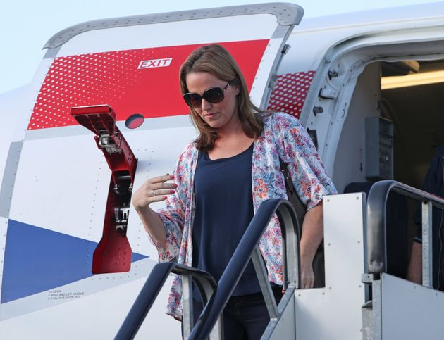 Hannah Deacon, the mother of Alfie Dingley, steps off a British Airways flight at London Airport after...