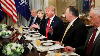 U.S. President Donald Trump gestures as he and U.S. Secretary of Defence James Mattis, U.S. Secretary of State Mike Pompeo attend a bilateral breakfast with NATO Secretary General Jens Stoltenberg ahead of the NATO Summit in Brussels, Belgium July 11, 2018. REUTERS/Kevin Lamarque