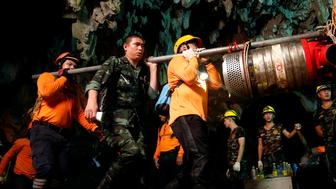 Rescue workers and soldiers take out machine after 12 soccer players and their coach were rescued in Tham Luang cave complex in the northern province of Chiang Rai, Thailand, July 10, 2018. REUTERS/Soe Zeya Tun