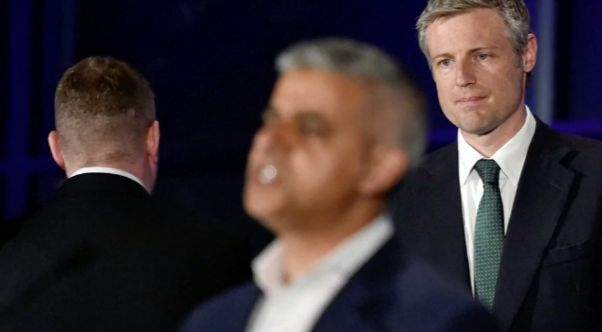 Britain First leader Paul Golding turns his back on Sadiq Khan during the mayor's victory speech while...