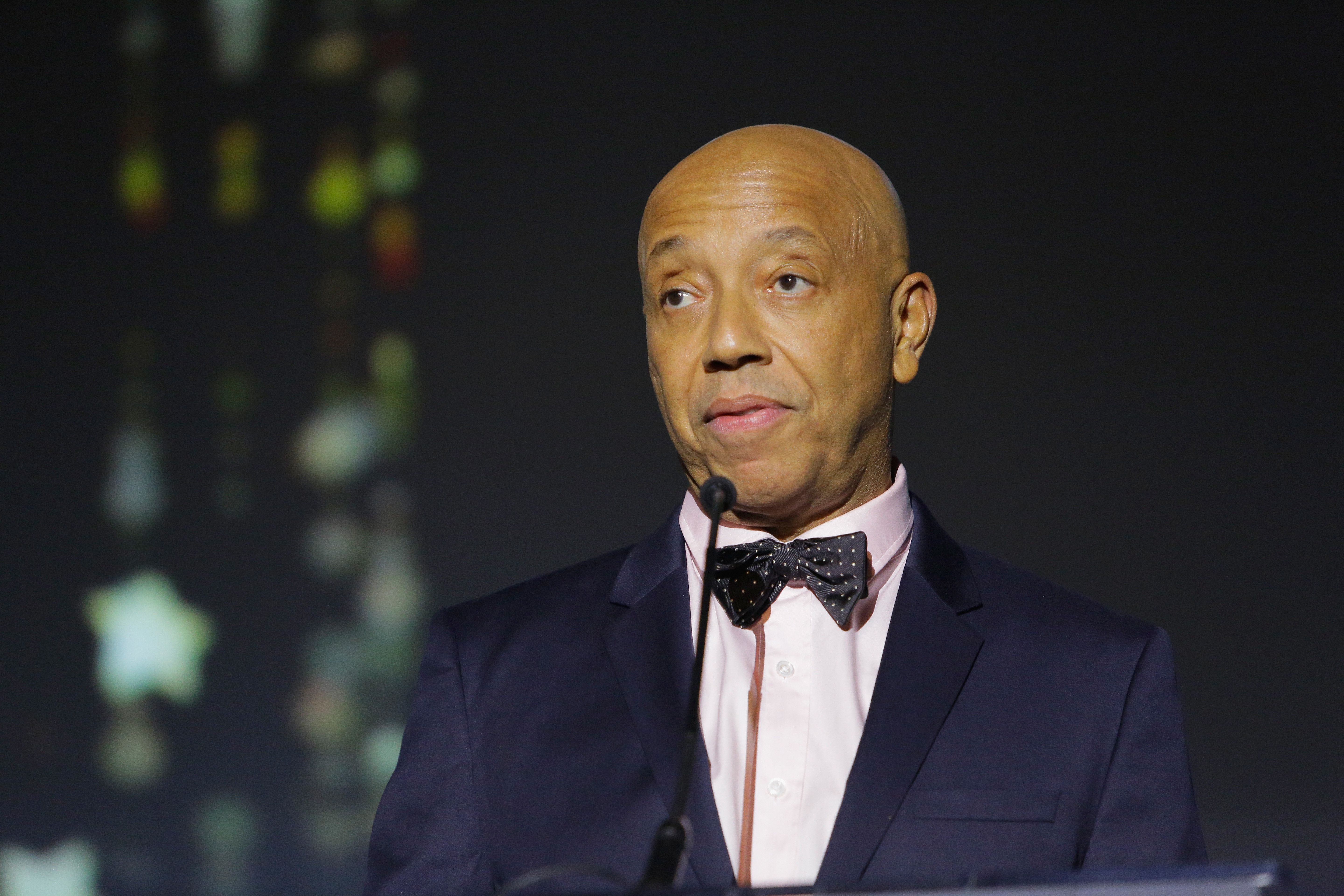 LOS ANGELES, CA - NOVEMBER 09:  Music producer Russell Simmons speaks onstage at the 2017 Make a Wish Gala on November 9, 2017 in Los Angeles, California.  (Photo by Tiffany Rose/Getty Images for Make A Wish)
