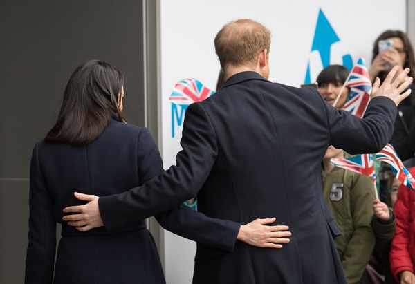 The couple has each other's backs during a visit to Millennium Point in Birmingham, England, on March 8.