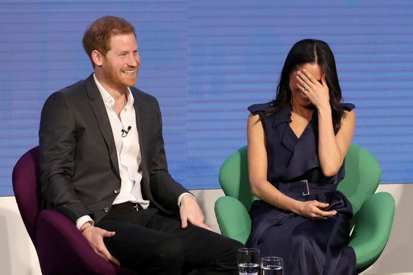 The couple shares a laugh at the first annual Royal Foundation Forum held on Feb. 28 in London.