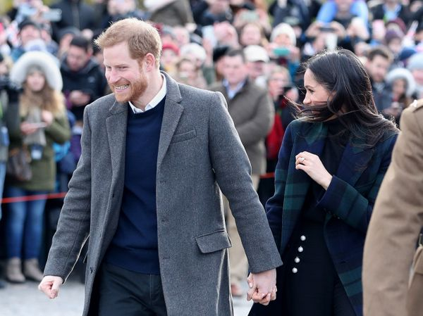 Harry and Meghan hold hands during their visit to Edinburgh Castle in Scotland on Feb. 13.