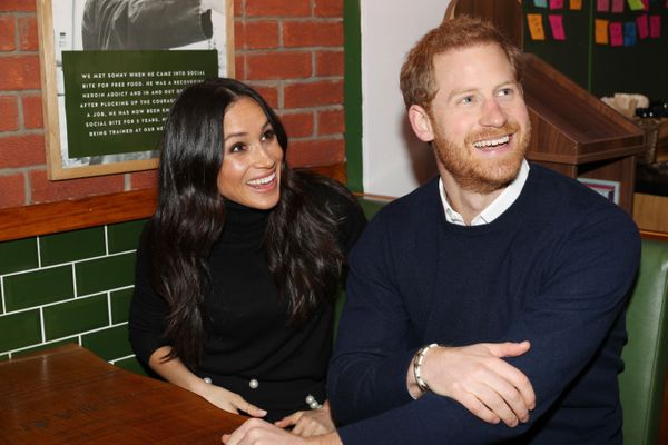 Harry and Meghan are all smiles during their Feb. 13 visit to Social Bite, a social enterprise cafe, in Edinbu