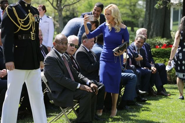 White takes photos duringa National Day of Prayer event in the Rose Garden onMay 3,