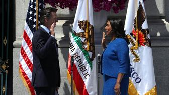SAN FRANCISCO, CA - JULY 11:  California Lt. Gov. Gavin Newsom (L) administers the oath of office to San Francisco mayor London Breed during her inauguration at San Francisco City Hall on July 11, 2018 in San Francisco, California. London Breed made history after being sworn in as the first black woman to be elected as mayor of San Francisco. Breed will finish out the term of former San Francisco mayor Ed Lee who died unexpectedly last year.  (Photo by Justin Sullivan/Getty Images)
