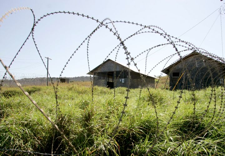 Buildings stand empty and overgrown at the Guantanamo Bay camp now that the prisoner population is down to 40.
