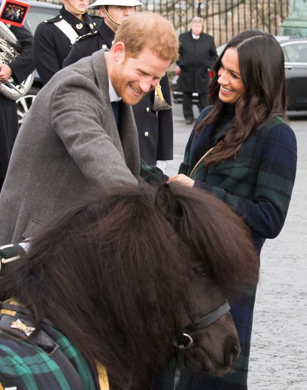 Harry and Meghan meet a Shetland pony during a visit to Edinburgh Castle on Feb. 13 in Edinburgh, Scotland.