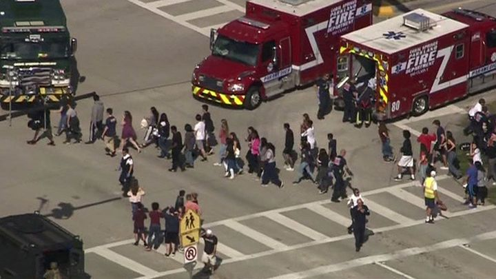 A still image in a video from WSNV.com shows students being evacuated from Marjory Stoneman Douglas High School on Feb. 14, 2