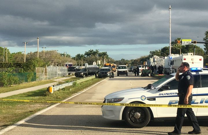 Police patrol the area outside Marjory Stoneman Douglas High School following the school shooting in Parkland, Florida.