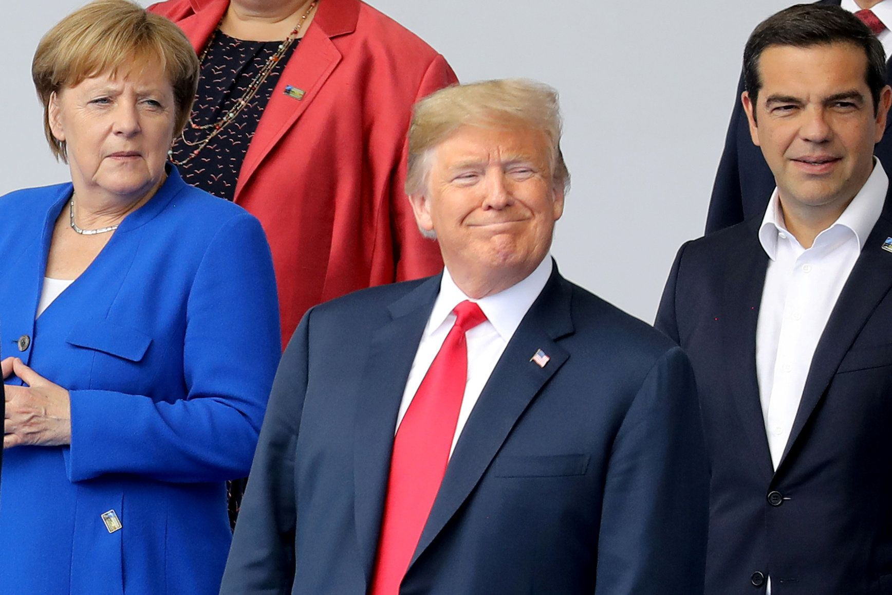 German Chancellor Angela Merkel, U.S. President Donald Trump and Greek Prime Minister Alexis Tsipras pose for a family picture ahead of the opening ceremony of the NATO (North Atlantic Treaty Organization) summit, at the NATO headquarters in Brussels, Belgium July 11, 2018. Ludovic Marin/Pool via REUTERS