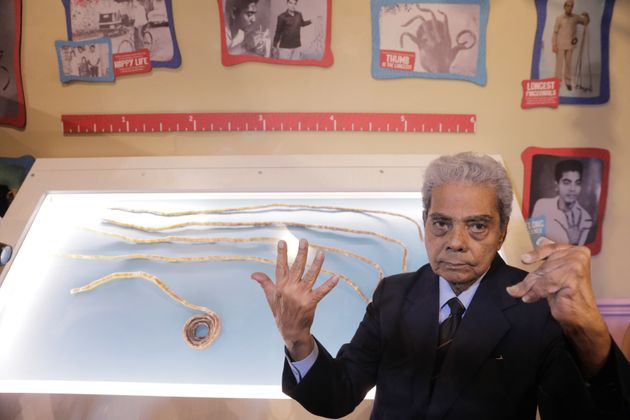 Shridhar Chillal of India displays his newly cut fingernails at an announcement that the five fingernails...
