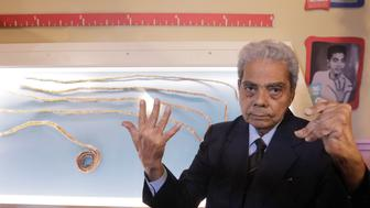 Shridhar Chillal of India displays his newly cut fingernails at an announcement that the five fingernails he grew for 66 years will be displayed in Ripley's Believe it or Not in New York, U.S., July 11, 2018. REUTERS/Lucas Jackson