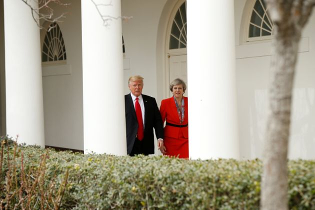 Donald Trump escorts Theresa May after their meeting at the White House in Washington in January,