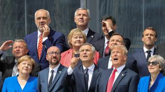 (First row L-R) German Chancellor Angela Merkel, Belgium's Prime Minister Charles Michel, NATO Secretary General Jens Stoltenberg, US President Donald Trump, Britain's Prime Minister Theresa May (second row L-R) Denmark's Prime Minister Lars Lokke Rasmussen, Norway's Prime Minister Erna Solberg, Poland's President Andrzej Duda, French President Emmanuel Macron (third row) Albania's Prime Minister Edi Rama, Czech Republic President Milos Zeman and Spain's Prime Minister Pedro Sanchez pose for a family picture ahead of the opening ceremony of the NATO (North Atlantic Treaty Organization) summit, at the NATO headquarters in Brussels, Belgium July 11, 2018. Ludovic Marin/Pool via REUTERS     TPX IMAGES OF THE DAY