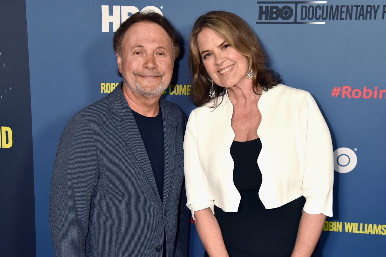 """Billy Crystal and Marina Zenovich attend the Los Angeles premiere of """"Robin Williams: Come Inside My Mind"""" from HBO on June 27."""