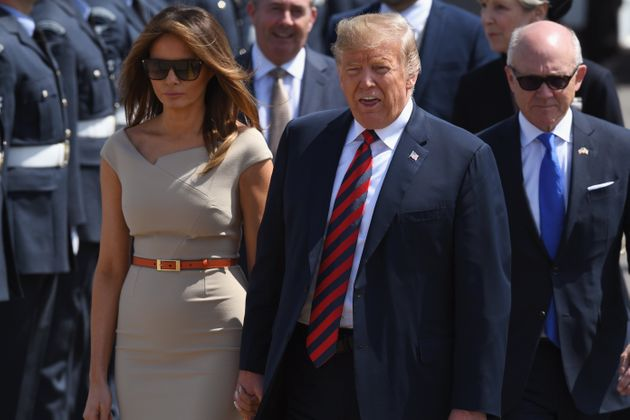 The US presidentand first lady arrive at Stansted