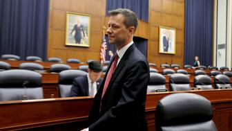 """FBI Deputy Assistant Director Peter Strzok arrives to testify before House Committees on the Judiciary and Oversight & Government Reform joint hearing on """"Oversight of FBI and DOJ Actions Surrounding the 2016 Election"""" in Washington, U.S., July 12, 2018.  REUTERS/Joshua Roberts"""