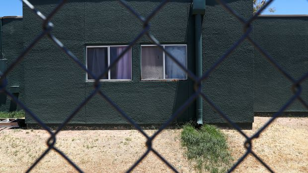 Windows are seen behind chain link fencing at an immigration detention facility for children run by Southwest Key Programs and the U.S. Department of Health and Human Services as U.S. first lady Melania Trump tours the facility in Phoenix, Arizona, U.S., June 28, 2018.    REUTERS/Leah Millis