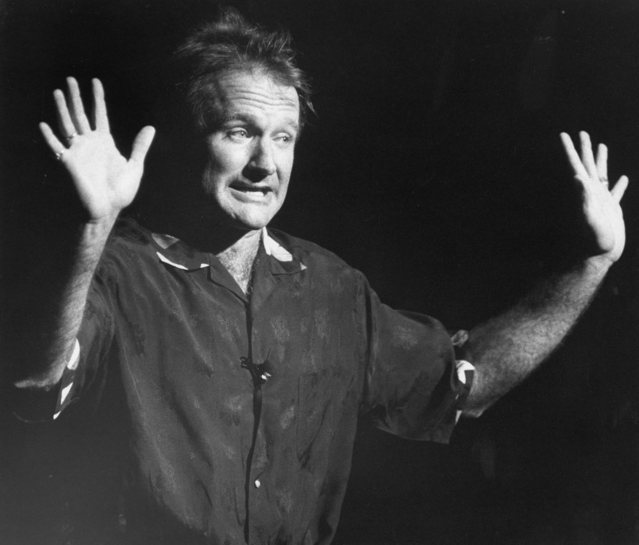 Robin Williams performs stand-up comedy during a fundraiser to benefit John Kerry's Senate campaign at the Wang Center in Boston on Oct. 23, 1990.