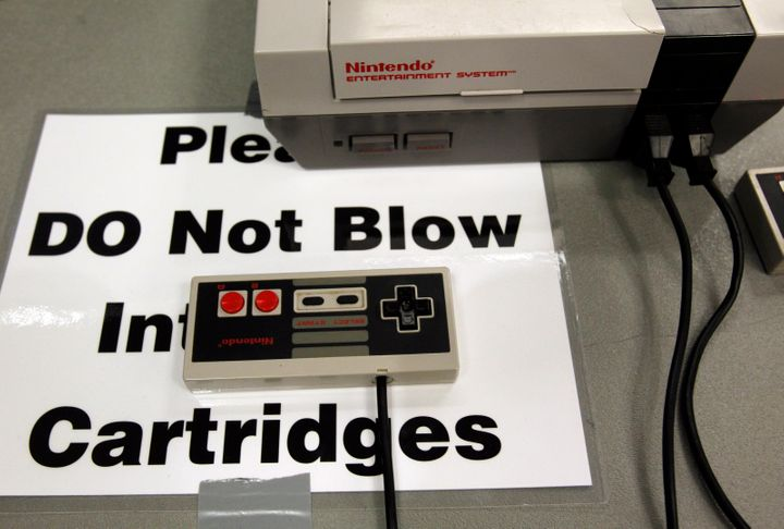 Blowing into old video game cartridges was common years ago, but a lot of gamers now recommend avoiding the practice since it can damage the games. The PAX East gaming conference (above) made that message explicit to its guests.