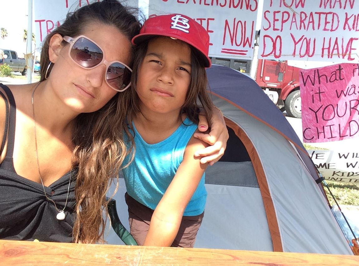 """The author and her 7-year-old son Gabe in front of their encampment just outside theCasa El Presidente """"tender age"""" she"""