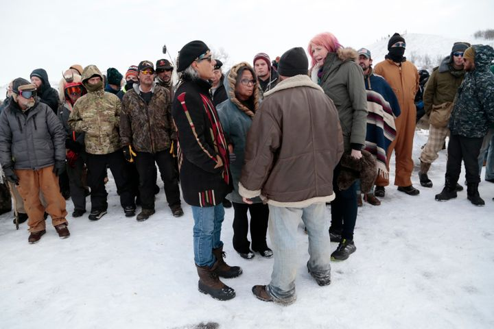 Phyllis Young of the Standing Rock Sioux tribe, center, talks with veterans who oppose the Dakota Access pipeline and lo