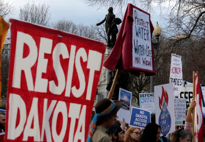 People protest President Donald Trump's directive to permit the Dakota Access pipeline at the White House on Feb. 8, 2017.&nb