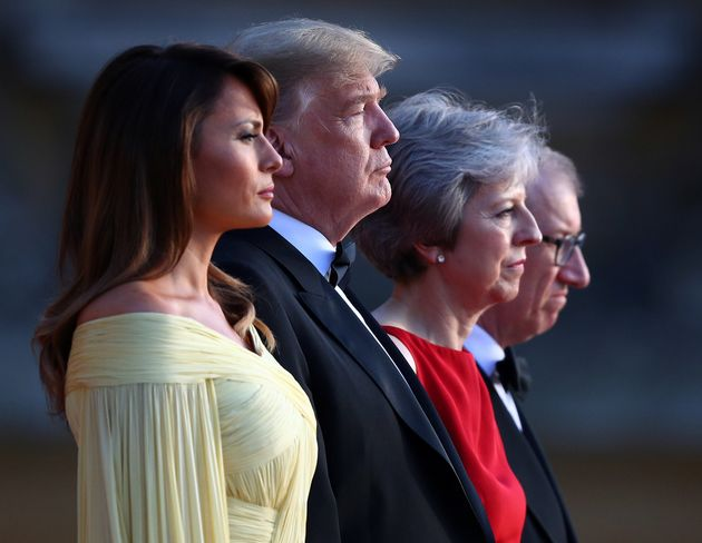 British Prime Minster Theresa May and her husband Philip stand together with U.S. President Donald Trump...