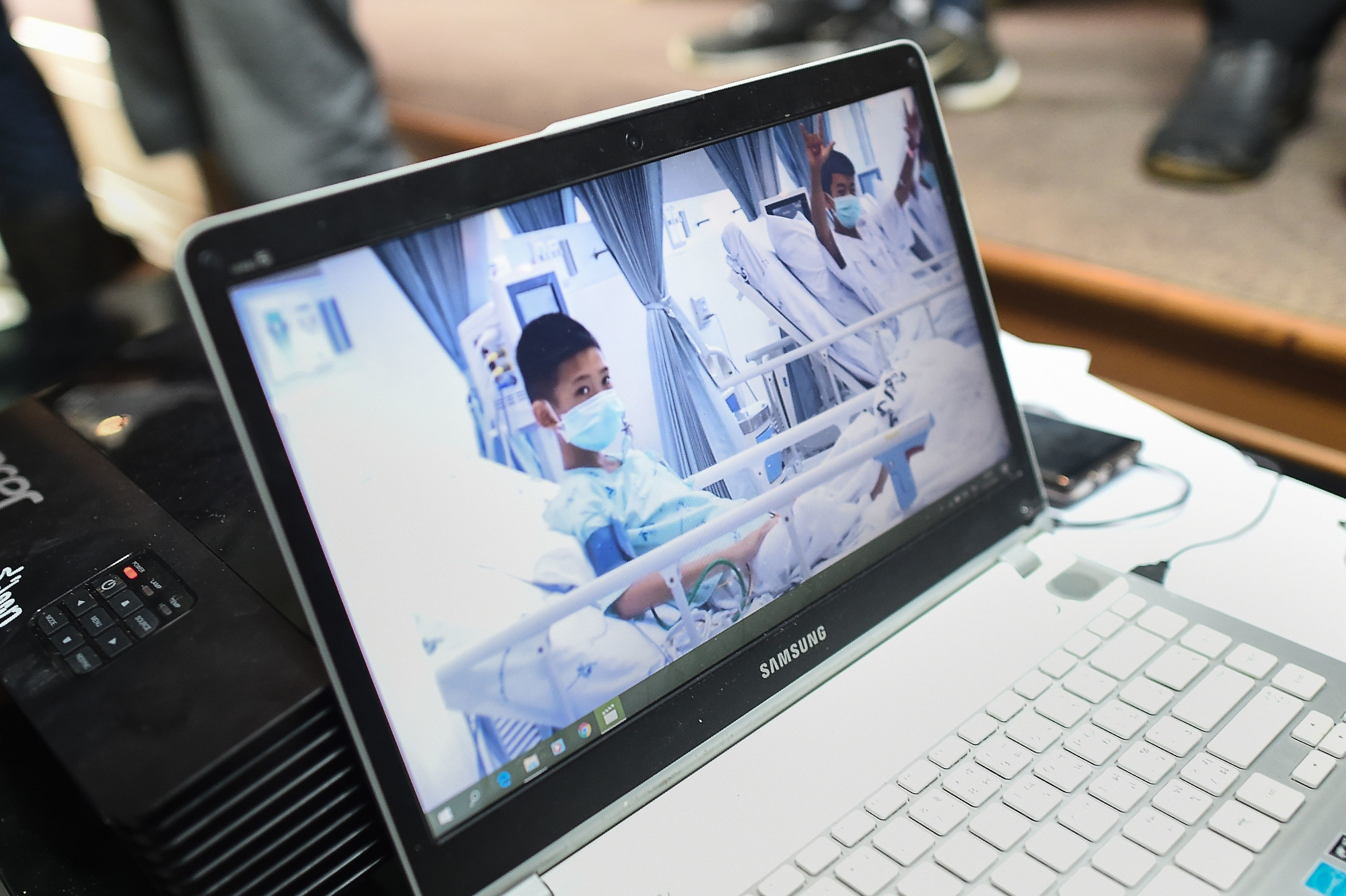 A laptop projecting video of the rescued soccer players at a press conference in Mae Sai, Thailand, July 11. T