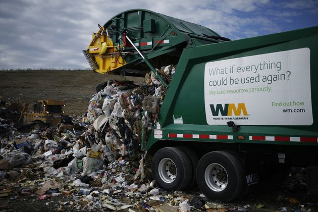 A garbage truck dumps trash at a landfill in Ferris, Texas. Organic material makes up most of the waste...