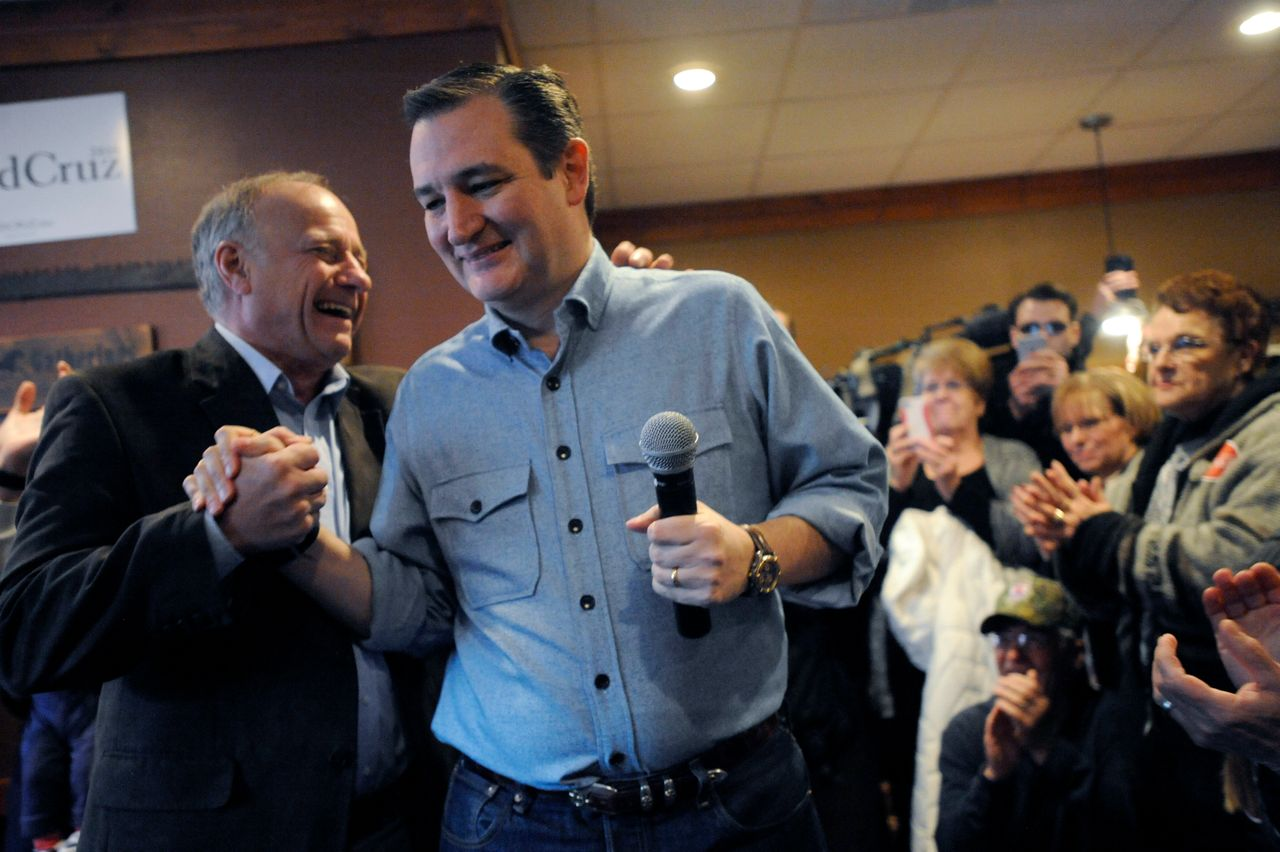 Sen. Ted Cruz, then a Republican presidential candidate, shakes hands with King at a campaign stop in Iowa on January 7, 2016.