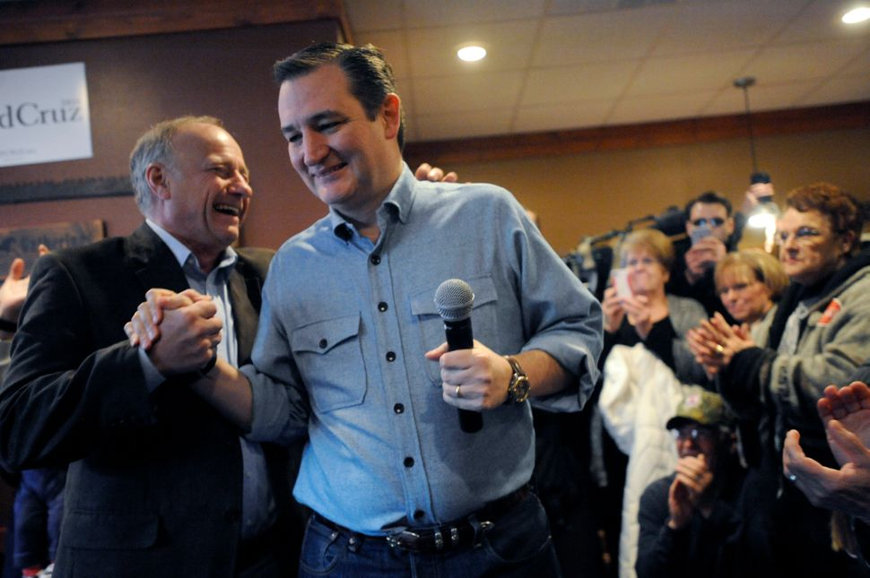 Sen. Ted Cruz, then a Republican presidential candidate, shakes hands with King at a campaign stop in Iowa on January 7, 2016