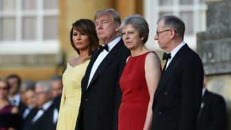 US President Donald Trump and US First Lady Melania Trump stand with Prime Minister Theresa May and her husband Philip May arrive at Blenheim Palace, Oxfordshire, ahead of a dinner as part of his visit to the UK.