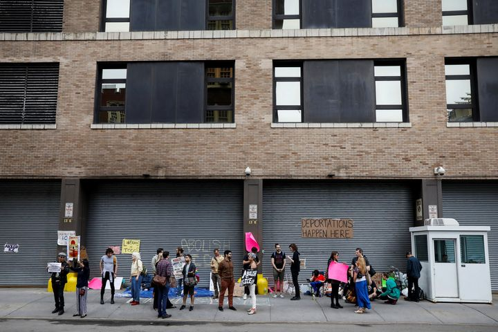 Demonstrators gather outside a building that houses the Immigration and Customs Enforcement offices in New York City on June