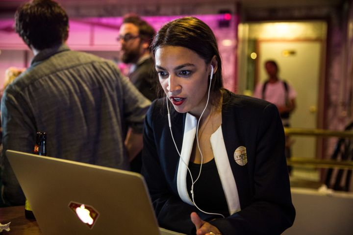 Progressive challenger Alexandria Ocasio-Cortez celebrates at a victory party in the Bronx, New York, after upsetting in