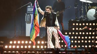 NEW YORK, NY - JUNE 21:  Harry Styles holds rainbow flags as he performs onstage during Harry Styles: Live On Tour - New York at Madison Square Garden on June 21, 2018 in New York City.  (Photo by Kevin Mazur/Getty Images for HS)
