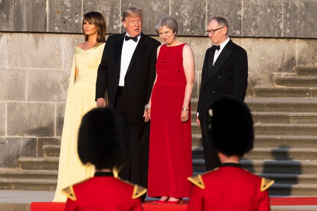 Trump and his wife Melania stand with Prime Minister Theresa May and her husband Philip May at Blenheim...