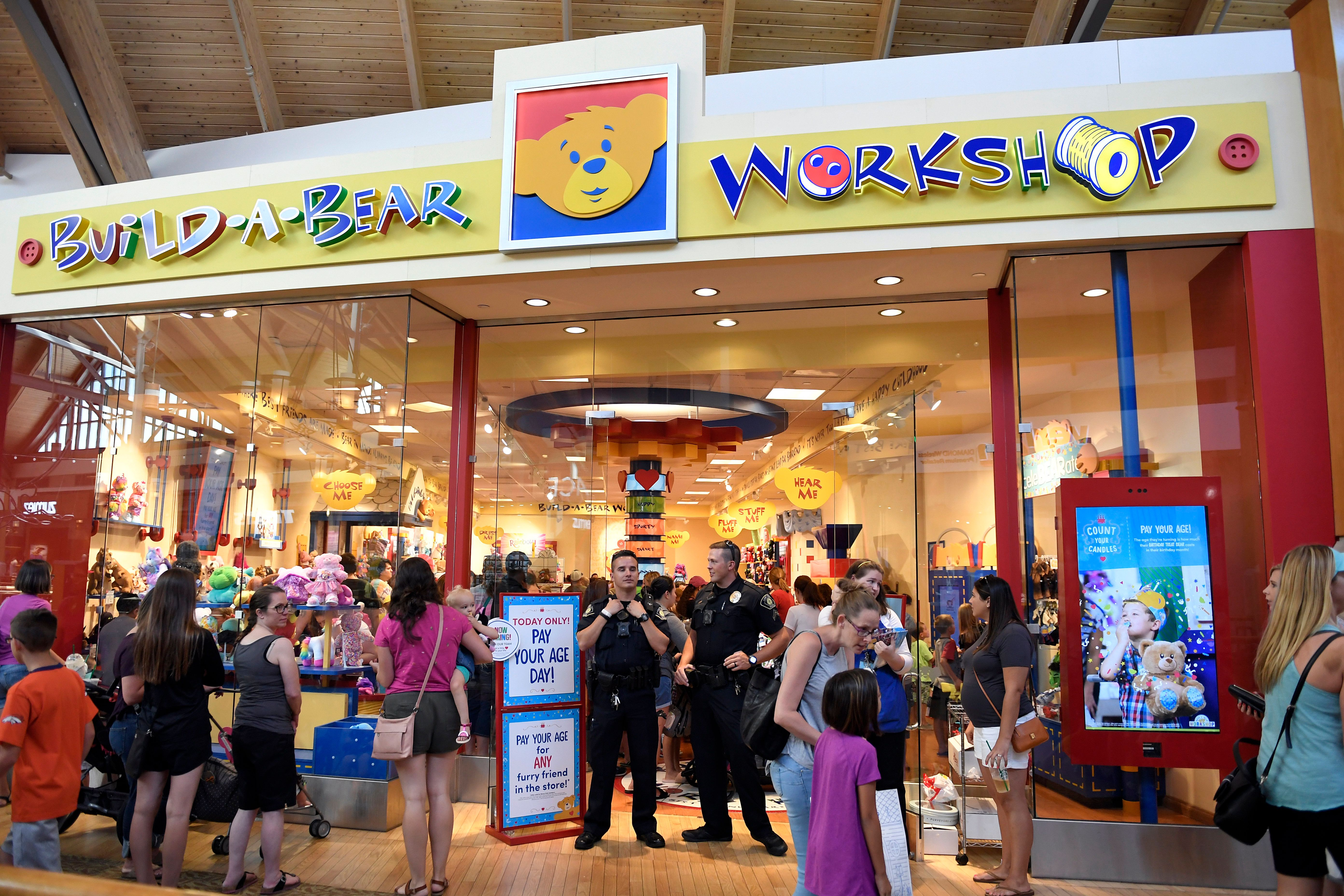LONE TREE, CO - JULY 12: Lone Tree Police help at the front door of the Build-A-Bear store as lines stretched almost all the way around the second floor of Park Meadows Mall. Malls in metro Denver, Loveland and across the country shut down a promotion where plush bears could be purchased at a price matching a customers age July 12, 2018 in Lone Tree, Colorado. (Photo by Joe Amon/The Denver Post via Getty Images)