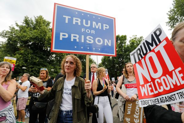 Protesters gathered near an entrance to the U.S. ambassador to the U.K.'s residence in London on July 12, 2018 as Trump