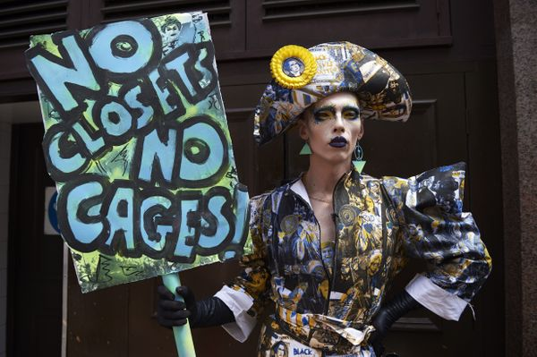 A drag queen joins protesters against the UK visit of US President Donald Trump as they gather to take part in a march and ra